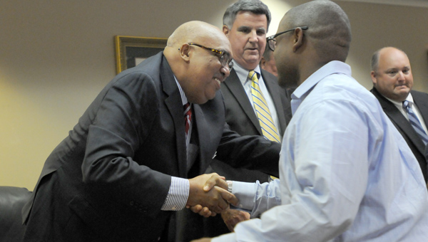 Jimmy Lawson, left, is congratulated on his appointment to the Greenville City Council. Lawson will fill the seat of longtime Councilman James Lewis, who passed away July 5. (Advocate Staff/Andy Brown)