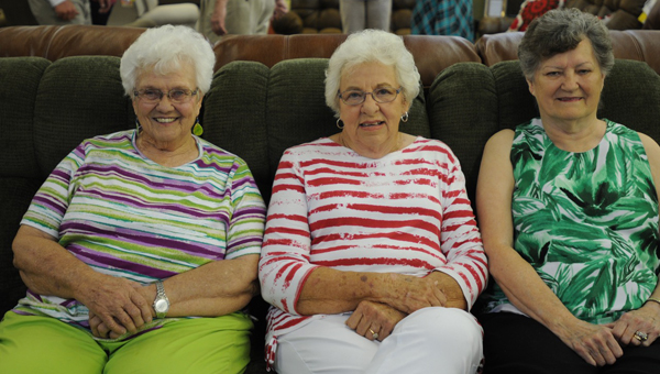 Johnson Furniture held its soft opening on Wednesday. Pictured are, from left to right, Joyce Till, Myrlean Hitson and Betty Thomas enjoying one of the many sofas offered at Johnson Furniture.  (Advocate Staff/Beth Hyatt)