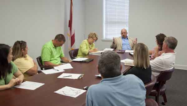 Representatives from SMART Alabama, Dongwon, Crenshaw Chamber and Crenshaw County Schools discuss the formation of a new industrial engineering track for high school students during Thursday's meeting.