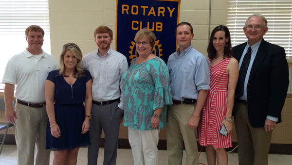 The Rotary Club of Greenville inducted three new members on Thursday. Brian Moss, Glenn Cooper and Russell Hill joined the club, which was charted in Greenville in 1939. Pictured are, from left to right, Howard Meadows, club president; Rachel Moss; Brian Moss; Glenn Cooper; Russell Hill; Brooke Hill; and Dr. Jim Krudop, club membership chairman. (Advocate Staff/Andy Brown)