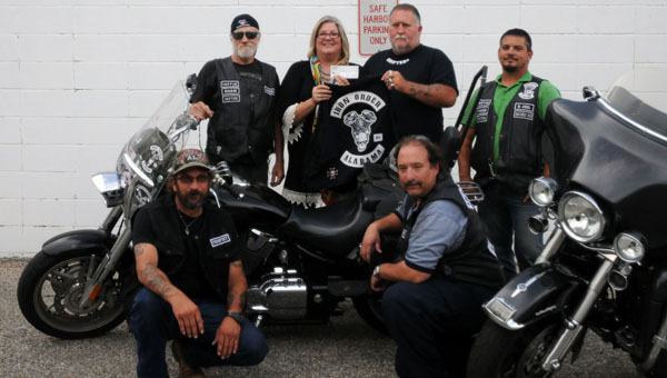The Iron Order Motorcycle Club donated $500 to Safe Harbor on Tuesday. Pictured are, front row, from left to right, Gene Cornwell and Butch Sims. Back row, from left to right, Don Addison; Kathy Smyth, Safe Harbor executive director; Dana Watson, president; and Scott Boutwell, business manager. (Advocate Staff/Andy Brown)