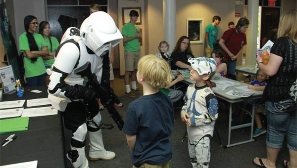 A Scout Trooper with the Alabama 501st Legion Star Wars Costuming Group chats with two attendees at last year's Star Wars Day held at the Greenville-Butler County Public Library. Star Wars Day 2015 starts Saturday at 10 a.m. at the library. (File Photo)