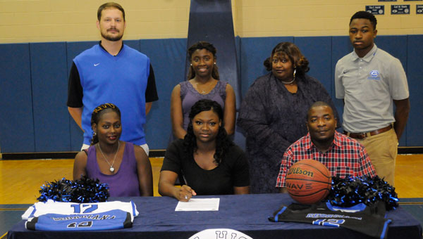 Georgiana standout Zandreca Johnson has signed a full athletic scholarship to play basketball for Bishop State Community College in Mobile.  Pictured in front, from left to right:  Patricia McMeans, Zandreca Johnson and Lovell McMeans.  Back row:  Kirk Norris, Dyvonda Johnson, Barbara Mobley and Matt Campbell.