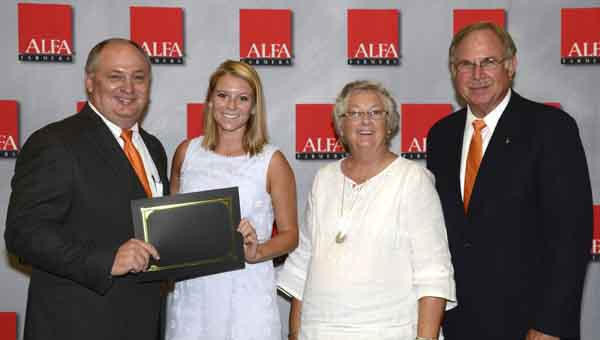 CONTRIBUTED PHOTO Auburn University student and scholarship recipient Richelle Thomas of Highland Home was honored at the Alabama Farmers Federation 2015 Scholarship Recipients Luncheon Aug. 22 at the Ham Wilson Arena in Auburn. Thomas graduated from Luverne High School and is studying food science. The $1,750 scholarship was funded by the Crenshaw County Farmers Federation and the Federation's Alabama Farmers Agriculture Foundation. From left are Federation President Jimmy Parnell, Thomas, Crenshaw County Farmers Federation President Linda Pierce and Federation Southeast Region Vice President George Jeffcoat.