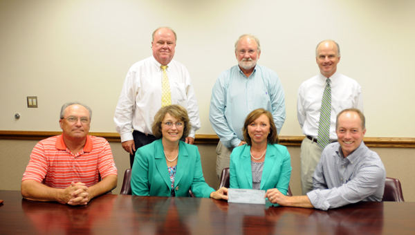 The Butler County Commission for Economic Development presented the Butler County Board of Education with a $4,000 donation on Monday for the Career Tech Academy. Pictured are, first row, from left to right, Steve Norman, BCCED board member; Jennifer Burt, career tech director for Butler County Schools; Amy Bryan, superintendent for Butler County Schools; and Rod Cater, BCCED board member. Second row, from left to right, Dexter McLendon, mayor of the City of Greenville, David Hutchison, executive director of the BCCED; and Jim Dunklin, BCCED board member. (Advocate Staff/Andy Brown)