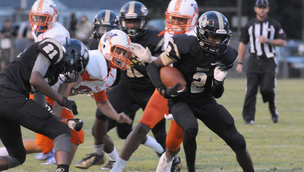 Greenville High School senior defensive back A'Darius Bowen returns a fumble during the Tigers' 34-13 win over Valley High School Friday night at Tiger Stadium. (Advocate Staff/Andy Brown)