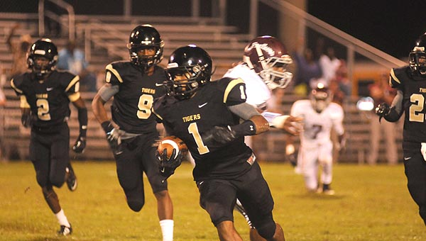 Greenville High School senior defensive back Ja'Quan Lewis  returns an interception during the third quarter of the Tigers' 35-22 win over Elmore County High School Friday night at Tiger Stadium. Greenville will open the regular season next Friday night against Valley High School. (Advocate Staff/Andy Brown)