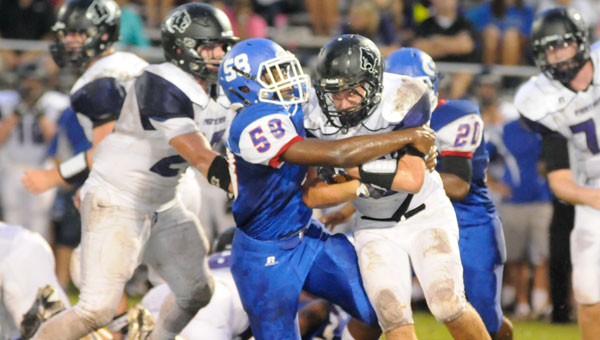 Georgiana School junior linebacker Quanterrius Pressley brings down a Prattville Christian ballcarrier during the Panthers' 48-26 win Friday night.