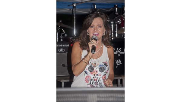 Lisa Rolling sings during the inaugural Pepsi Pavilion karaoke event. Have your turn Sat., Aug. 15, at 7:30 p.m.