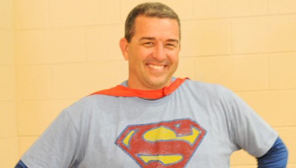 Greenville Elementary School Principal Kent McNaughton donned his Superman suit for Institute Day on Monday.  (Advocate Staff/Beth Hyatt)