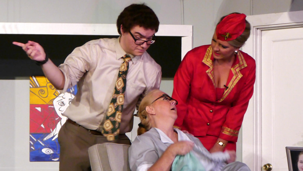 Robert (Norman Schmitz) and Gabriella (Alaina Norman) come to the aid of a very flustered Berthe (Johnna Pitts). (Advocate Staff/Angie Long)