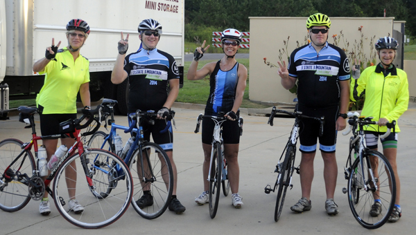 Five participants in the MS 450 bike ridetraveling to Orange Beach from Birmingham in order to raise funds and awareness of Multiple Sclerosis made a stop in Greenville Wednesday. On Saturday and Sunday, they will compete in the final 150 miles of the ride in the Tour de Beach event. The group set out on their second day of biking Thursday morning. Pictured are, from left to right, Jan Bell, Rich Akers, Stacey Davis, Jeff Morez and Grace Ragland. (Advocate Staff/Beth Hyatt)