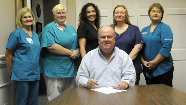 Greenville Mayor Dexter McLendon signed a proclamation Monday proclaiming October as National Breast Cancer Awareness Month. On hand for the signing were, from left to right, Linda Hall, Donna Raybon, Monica Stringer, Felicia Killough and Joann Mathews of SouthernCare Hospice. (Advocate Staff/Andy Brown)