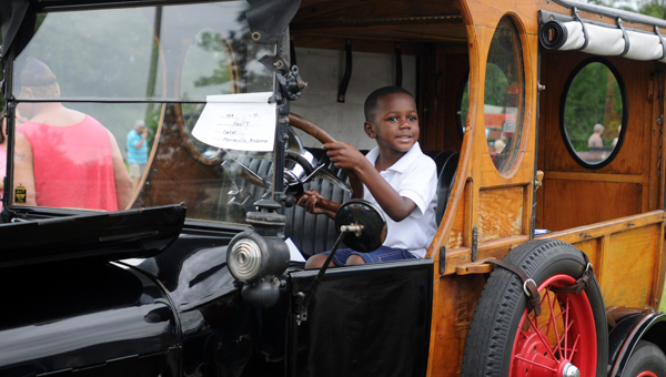 Julian Thompson, 4, slips behind the wheel of a 1919 Ford Model T. The car belonged to Gator Gould from Monroeville. (Advocate Staff/Andy Brown)