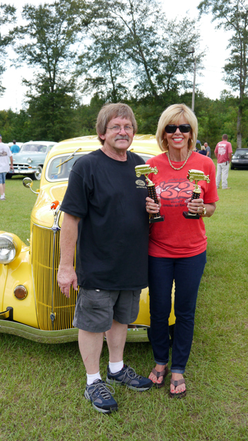 Ronnie Adams' 1936 Ford two-door sedan won Best of Show at Saturday's car show. He is pictured with his wife, Jane. (Advocate Staff/Angie Long)