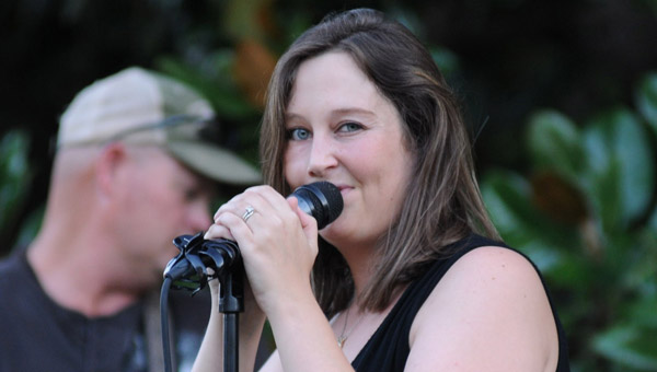 Nearly 100 people turned out to enjoy the music of Rosie McClain Till (pictured), David Jackson, Michael Smith, Jason Owens, David Buck, Rylee Andrews and Robbin McCombs perform Saturday night in Confederate Park. (Advocate Staff/Andy Brown)