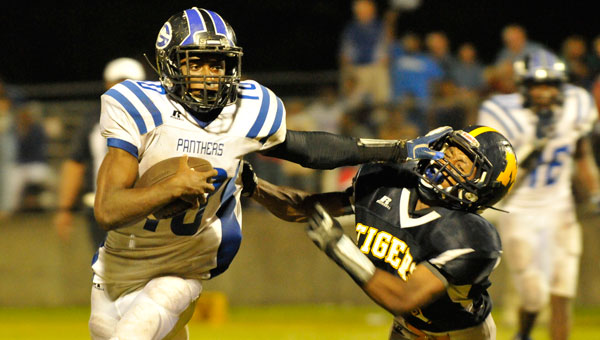 Georgiana quarterback Jacquez Payton (left) narrowly avoids Chris Shufford during 2014's 46-12 loss to McKenzie.  Both undefeated teams currently sit at the top of Class 1A Region 2.