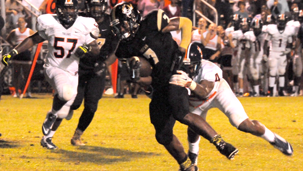 Greenville High School senior running back Skilar Moorer scored a 2-yard touchdown in the Tigers' 35-10 win over Charles Henderson High School Friday night. (Advocate Staff/Andy Brown)