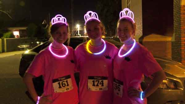 JOURNAL PHOTO | MONA MOORE Left to right, Becky Lester, Annagrace Thomas and Bayli Register said they were excited to sign up for the run.