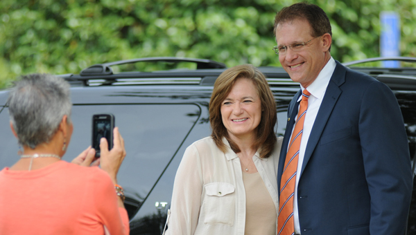 Auburn coach Gus Malzahn poses for a photo with Karen Fail in front of Greenville's City Hall Friday morning. (Advocate Staff/Andy Brown)