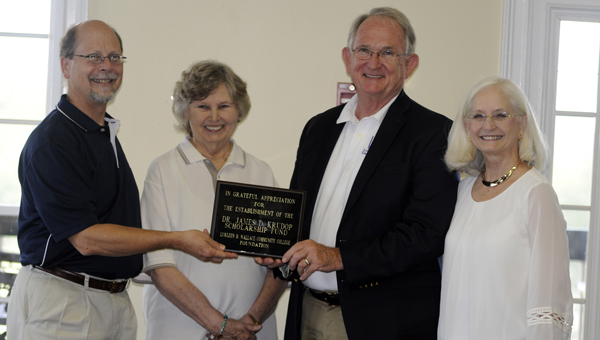 On Wednesday, the LBW Community College Foundation gifted Dr. Jim Krudop a plaque, which signified the establishment of the Dr. James D. Krudop Scholarship Fund. Pictured are, from left to right, Dr. Herbert Reidel, Dr. Jean Thompson, Dr. Jim Krudop and Holly Krudop. (Advocate Staff/Jonathan Bryant)