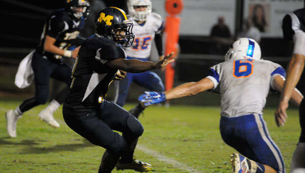 McKenzie running back Chris Shufford makes a Kinston defender miss in yet another impressive night on the ground.