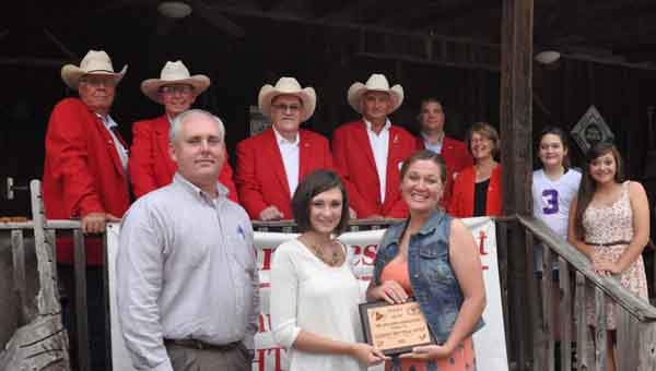 JOURNAL PHOTO | MONA MOORE Members of the American Cattlemen's Association join Amanda Reeves, Alabama Beef Ambassador, in presenting a plaque to Amy and Scottie Chandler, owners of The Old Barn Restaurant in Goshen. Pictured, left to right, are Max Bozeman Jr., Bill Hixon, Pike County Cattlemen's Association President B.B. Palmer, ACA Regional Vice President Larry Reeves, Coffee County Cattlemen's Association President Jamie Wyrosdick, Beverly Taylor, Abby Taylor and Jaycie Chandler. Front row, Scottie Chandler, Amanda Reeves and Amy Chandler.