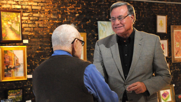 Steve Flowers greets Col. Eric O. Cates during a book signing Monday night at High Horse Gallery.