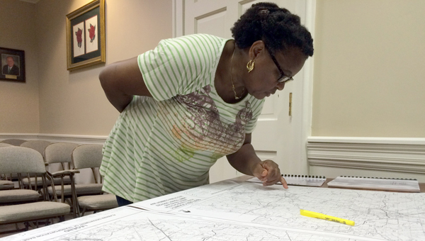 Easter Smith studies a map during a meeting held by the South Central Alabama Development Commission at Greenville's City Hall Thursday. (Advocate Staff/Andy Brown)