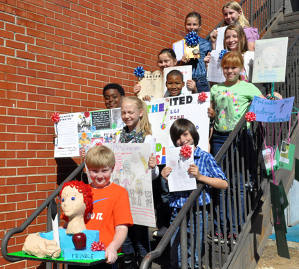 Several students were recognized for the quality of their language arts projects. In the front row is Cam Turner, second-place winner; second row, (left to right) second-place winners Raylee Lowe and Cy Carpenter; third row, second-place winners Zachary Shepherd, AJaylon Brown and Teri Sims; fourth row, first-place winners Cassidy Parsons and Meg White; fifth row overall winner Emma Foster and first-place winner Alina Brown. (Journal Staff/Mona Moore)