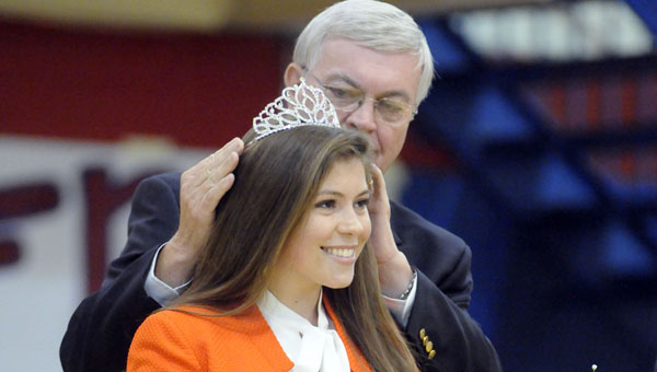 Fort Dale Academy Headmaster David Brantley crowns senior Hannah Miller during the school's homecoming assembly Friday morning. Miller, this year's Butler County Distinguished Young Woman, was selected as Fort Dale's homecoming queen.  (Advocate Staff/Jonathan Bryant)