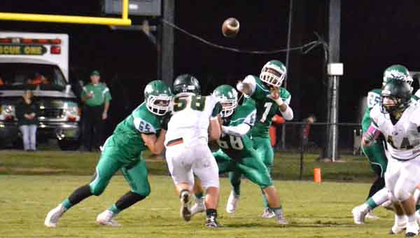 Tre Edwards (1) makes a pass as Colby Carpenter (65) and Garrett Barksdale (68) keep a Florala player at bay.
