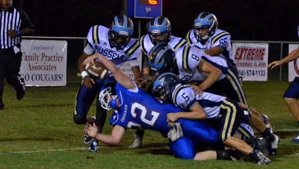 CONTRIBUTED  PHOTO  | MERICA TISDALE Crenshaw's Cole Roper reaches for the ball as a horde of Russell Christian players pile on him.