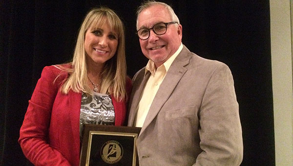 Dr. Tera Simmons, director of student learning for the Butler County School System, was named Alabama State Association for Health, Physical Education, Recreation and Dance Outstanding Administrator.  Simmons is pictured with her father, Lane Simmons.