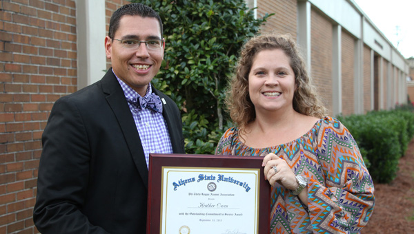 LBW Community College Dean of Student Affairs Jason Jessie, left, congratulates Heather Owen, director of recruitment, for receiving the Athens State University Phi Theta Kappa Alumni Association's first Outstanding Commitment to Service Award. The award recognizes advisors who have shown exceptional service both in their chapters and in the Alabama region. (Submitted Photo)