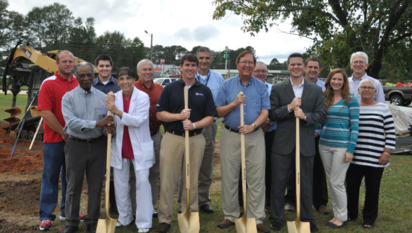 The City of Luverne proudly welcomes the construction of a new playground, which will be housed at E.L. Turner Park. Pictured first row, left to right, Charlie Johnson, council member; Sandy Walker, park board member; Greg Crouch, president of the Pepsi Bottling Co. of Luverne; Mayor Dr. Pat Walker; Travis Colquett, Kiwanis member; Diana Colquett; and Dale Shepherd, Kiwanis member. Second row, left to right, Lee Simmons, park director; Drew Warren, J.A. Dawson and Co.; Donnie Nix, Crenshaw County Chamber of Commerce president; Bobby Brasher, chief sales officer of Pepsi Bottling Co.; Kip Smith, council member; Troy Hudson, engineer; and Mike Jones, city attorney. (Journal Staff/Beth Hyatt)