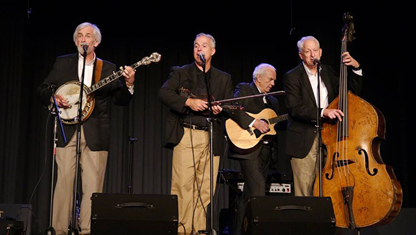Three on a String became a quartet during their Tuesday night performance when former member Andy McGinnis (far right) joined (from left) Bobby Horton, Brad Ryan and Jerry Ryan on stage to entertain the Ritz audience. (Advocate Staff/Angie Long)