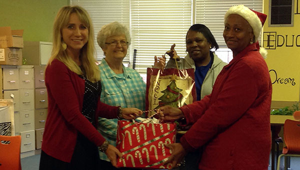 Greenville High School's Class of 1973 recently donated one hundred pairs of socks and underwear for both boys and girls to be distributed to pre-K students in need. Class representatives said they recognized an opportunity for outreach and hoped the gifts would help the children. Pictured are, from left to right, Dr. Tera Simmons, Kathy Atchison, Mary Sturgeon and Gloria Johnson. (Submitted photo)