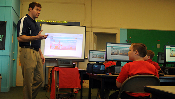 Matthew Shell, technology director for the Butler County School System, leads an Hour of Code session at Greenville Elementary School Friday morning. (Advocate Staff/Andy Brown)
