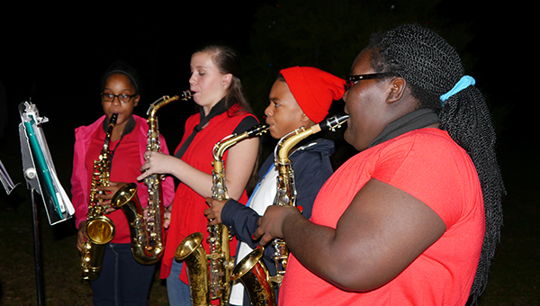 Members of the Georgiana School marching band perform at the City of Georgiana's annual Christmas tree lighting ceremony and concert Monday night. (Advocate Staff/Angie Long)
