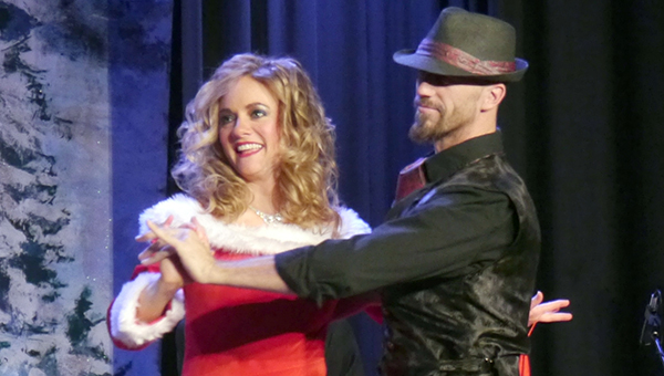 "Lindsey Benedict, sporting a red and white gown inspired by those worn in the classic film ""White Christmas"" performs with Mobile-based dance instructor Aaron Ferguson during the final segment of the show. (Advocate Staff/Angie Long)"