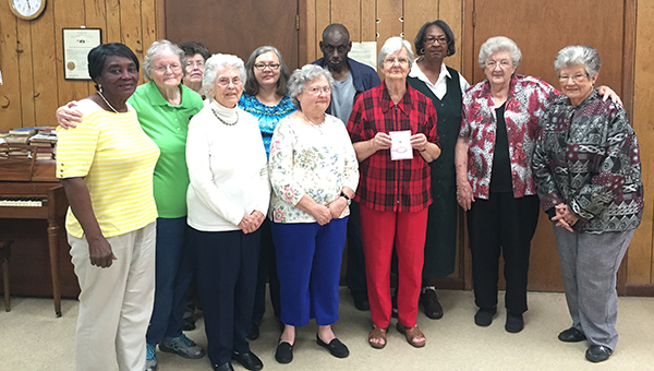 This past week, Brunese Thomas took the time to recognized and honor her volunteers for their dedication and service over the years. She presented each of them with a card expressing her heartfelt thanks for being good volunteers. Pictured are, first row from left to right, Chrys Boggart, Gwen Johsnon and Brunese Thomas. Pictured are, second row from left to right, Addie Cross, Betty James, Gloria Hughes, Janet Childs, Jessie Deoright, Thelma Salter, Doris Rogers and Edna Ruth Norsworthy. Volunteers not pictured are Curtis Green, Gwen Darget, Leon Singleton, Mary Dixon and Reva Motes. (Journal Staff/Beth Hyatt)