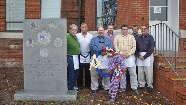 Butler County Masons placed a wreath next to the Operation Desert Storm monument at the Butler County Courthouse Saturday as part of the Wreaths Across America campaign. Wreaths Across America is a nonprofit organization started to continue and expand the annual wreath laying ceremony at Arlington National Cemetery started by Morrill Worcester in 1992. The organization helps coordinate wreath laying ceremonies on the second Saturday of December at Arlington, as well as veterans' cemeteries and other locations in all 50 states. Pictured are, from left to right, Bob George, Mike Shaw, Wesley Davenport, Terry Mullins, Byron Ward, Isaac Ward and Jerry Hardester. (Advocate Staff/ Beth Hyatt)