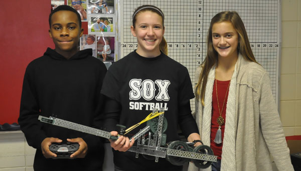 This semester, students at Luverne High School were given the chance to participate in a new organization called the Robitics Club. In this club, students have the chance to build their own robots and enter them into competitions with surrounding schools. Pictured are, from left to right,  Ashton McGhee, Libbey Jones and Riley Marchand. (Photo by Beth Hyatt)