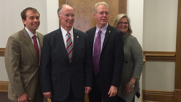 The Alabama Department of Economic and Community Affairs (ADECA) recently awarded a $84,800 grant to the Butler County Children's Advocacy Center (Safe Harbor). Pictured are, from left to right, David Saliba, Butler County Children's Advocacy Center board chairman; Gov. Robert Bentley; Rep. Chris Sells; and Kathy Smyth, Butler County Children's Advocacy Center director. (Advocate Staff/Andy Brown)