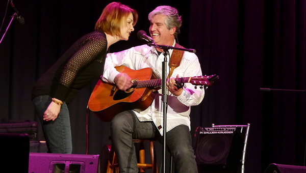 SteelDrivers' fiddler/vocalist Tammy Rogers surprises opening act Ricky Salley by joining in on a Reba McIntyre song penned by Salley. The SteelDrivers capped the Greenville Area Arts Council's 34th season with their performance Friday night at the historic Ritz Theatre in downtown Greenville. (Advocate Staff/Angie Long)