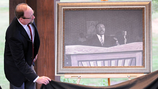 A photo of Dr. Martin Luther King, Jr., speaking at Greenville's Harrison Street Missionary Baptist Church will be presented to the church during Monday's annual MLK Breakfast. Pictured is Greenville-Butler County Public Library Director Kevin Pearcey unveiling the photo at a ceremony in October. (File Photo)