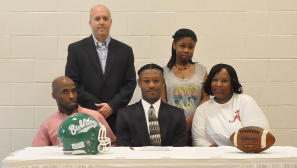 Brantley High School senior Savion Jones decided on Sunday that he would be officially signing on to play football at Iowa Central Community College.  A signing ceremony was held yesterday in the new BHS gym. Pictured are, first row from left to right, Wille Stamps, Jr., Savion Jones and Jacqueline Stamps. Pictured are, second row from left to right,  BHS head football coach Ashley Kilcrease and Jordan Jones. (Photo by Beth Hyatt)