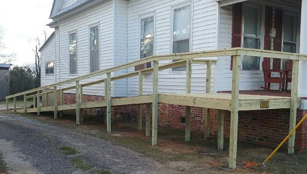 """When Lee Smith heard that a life-long resident of Highland Home, L.J. """"Jr."""" Best, was in need of an access ramp to his house, Smith wasted no time. Without a single charge to Best, Lee Smith Construction Company completed this project in a matter of three days."""