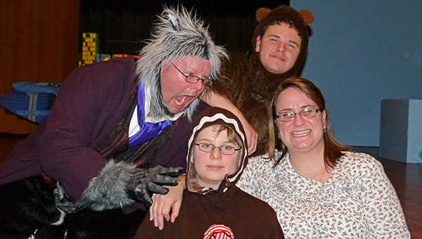 """Clockwise, director/actor Chris Pryor (The Big Bad Wolf),  Laun Pryor (Baby Bear), Naomi Pryor (Granny) and Laun Pryor (Friday night's Gingerbread Man) are in high spirits after the final performance of """"Rumpelstiltskin Private Eye"""" Saturday night at the Greenville High School Auditorium. (Advocate Staff/Angie Long)"""